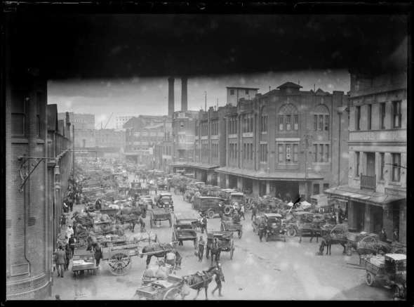 Horses and carts outnumbering motor cars at Paddy's Markets on Quay Street, Sydney, ca, 1920s [Source: NLA]