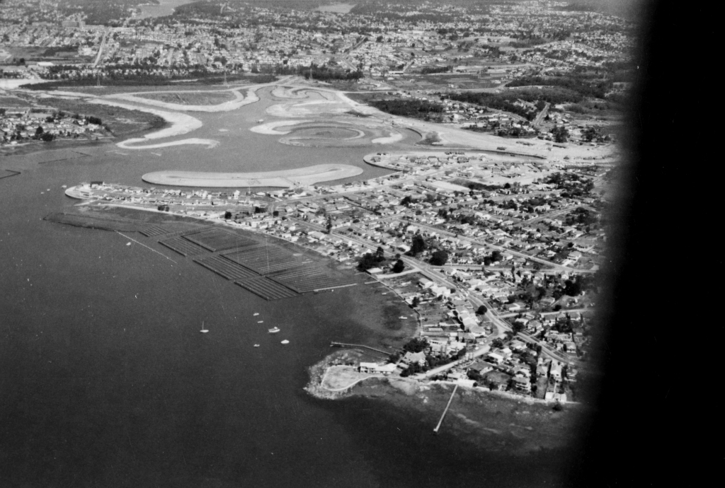 Aerial view of sutherland shire, showing sylvania waters under construction: land reclamation works showing islands being built out into the bay.